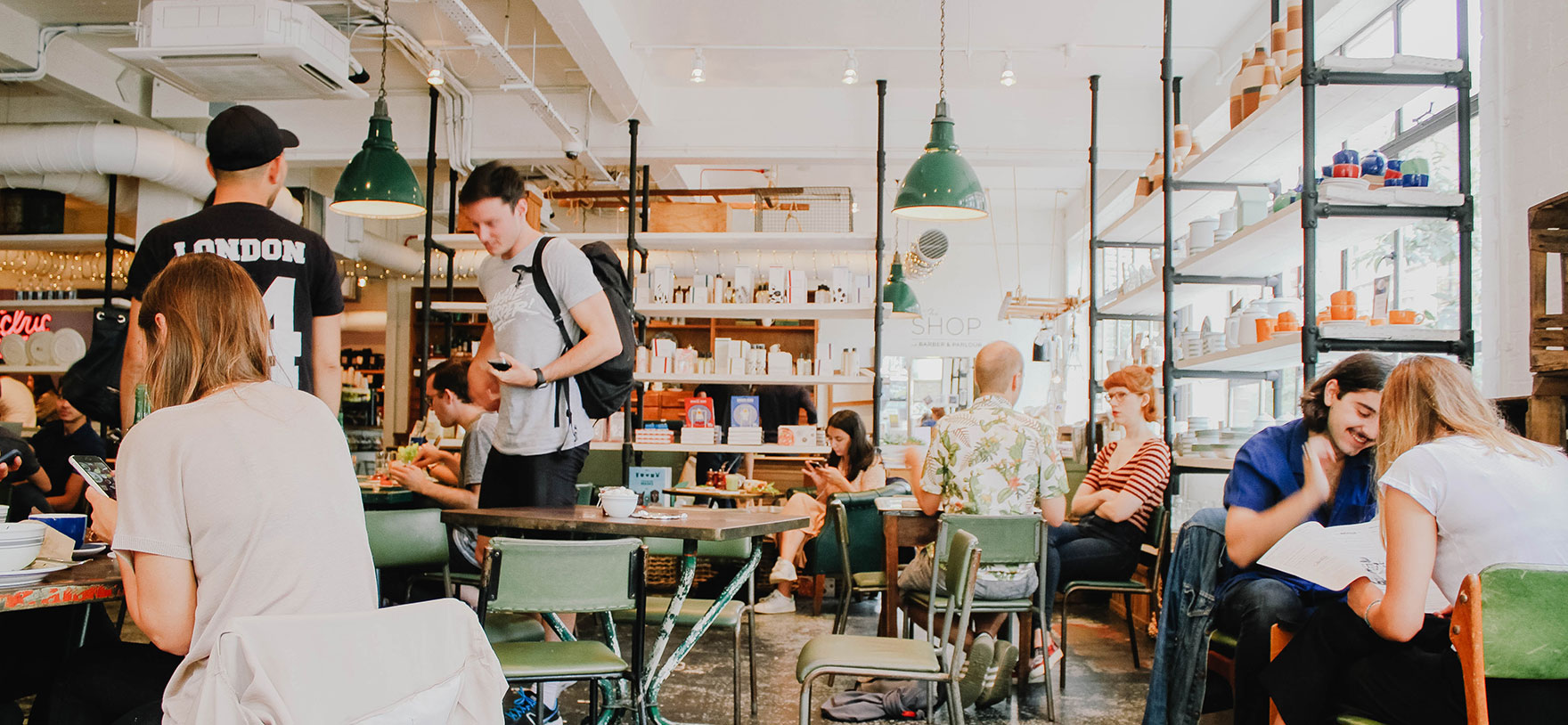 Image of young people in a busy coffee shop for Quotacy blog Why You May Be Avoiding Buying Affordable Life Insurance.