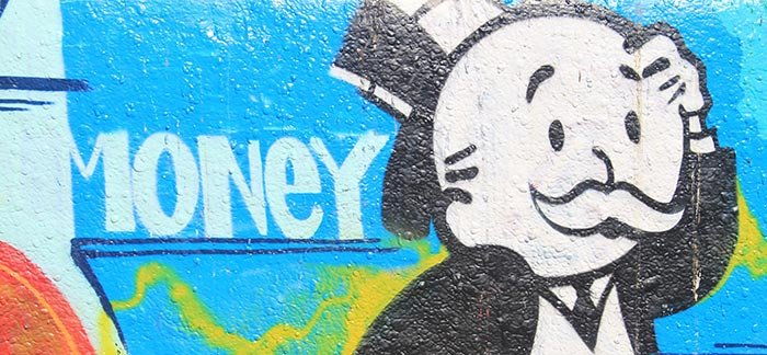 Image of graffiti with confused uncle pennybags and the word money for Quotacy blog Do I Pay to Apply for Life Insurance?