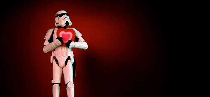 Image of Star Wars storm trooper holding a heart to his chest for Quotacy blog Getting Life Insurance After a Heart Attack.
