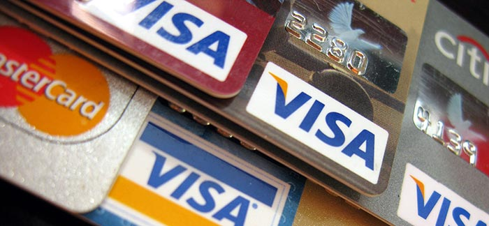 Image of stacked credit cards for Quotacy blog Habits of People with Good Credit.