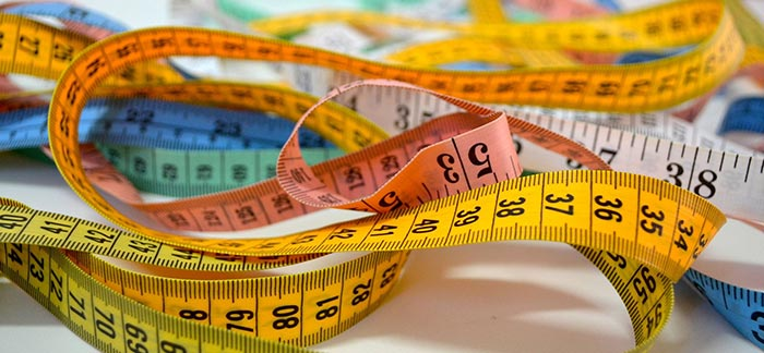 Image of multicolored tape measures for Quotacy blog Life Insurance and Obesity.