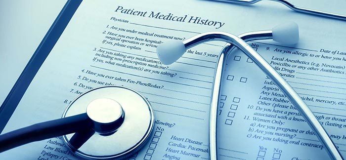 Image of stethoscope on a patient medical history form for Quotacy blog Life Insurance and Multiple Sclerosis: Buyer's Guide.