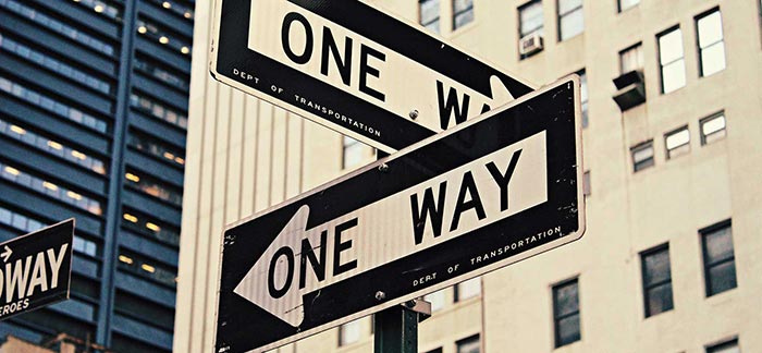 Image of two one way street signs crisscrossing for Quotacy blog How Do You Know if You're Buying the Right Life Insurance?
