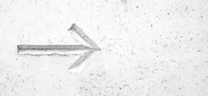 Image of arrow carved into a concrete wall for Quotacy blog Why Do Premiums Increase at the End of a Term Policy?