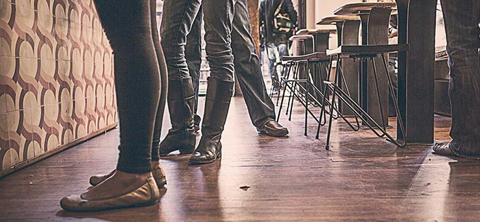 Image of people's legs and feet waiting in a coffee shop for Quotacy blog I'm a Millennial - Why Do I Need Life Insurance?