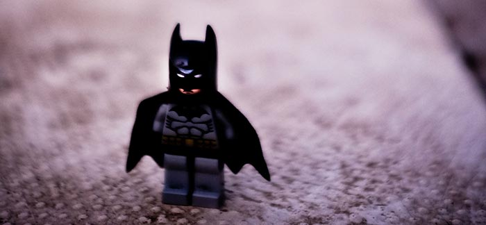 Image of Lego Batman standing on carpet for Quotacy blog Here's Why Batman Could Never Get Life Insurance.