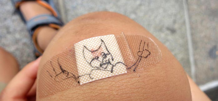 Image of X-Men Wolverine drawn on a band aid on a kids knee for Quotacy blog Everyday Superpowers: How Our Bodies Heal.