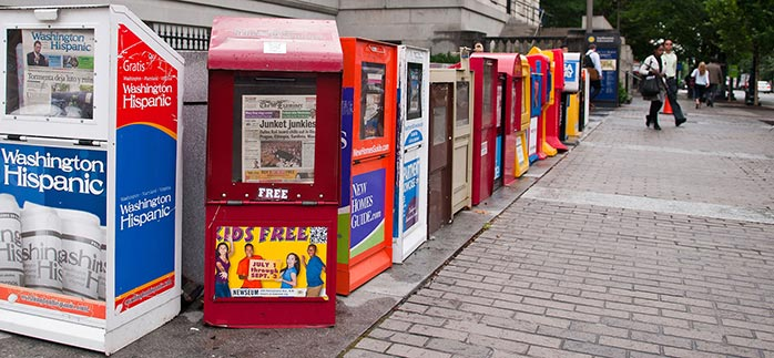 Image of newspaper vending machines in Washington DC for Quotacy newsletter How to Save, Spend, and Stretch Every Dollar.