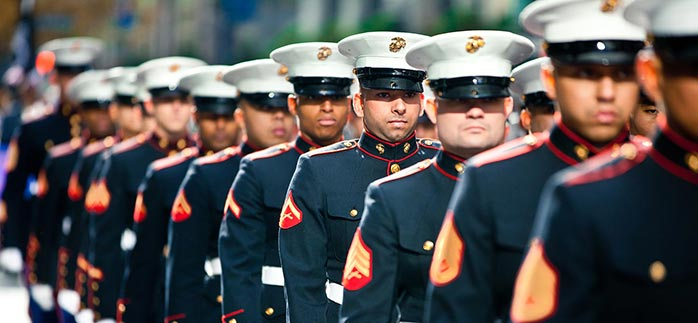 Image of line of military men in uniform for Quotacy blog Life Insurance in the Military.
