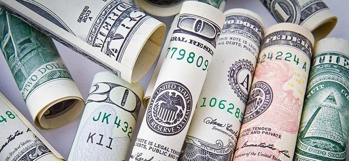 Image of rolled up cash or dollar bills for Quotacy blog What if My Premium Is Different Than Quoted?