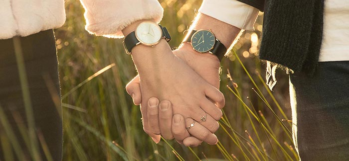 Image of two people holding hands in a grassy field for Quotacy newsletter Summer, Spending, and Soulmates.