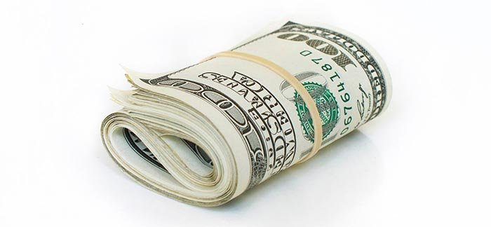Image of rolled up cash bound with rubber band for Quotacy blog What Is a Life Insurance Premium?