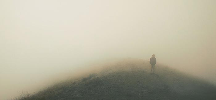 Image of person walking in fog for Quotacy blog Can Post-Traumatic Stress Disorder Affect Buying Life Insurance?