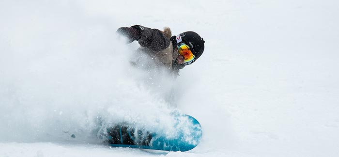 Image of a snowboarder for Quotacy blog Traumatic Brain Injury: How It Affects Health and Buying Life Insurance.