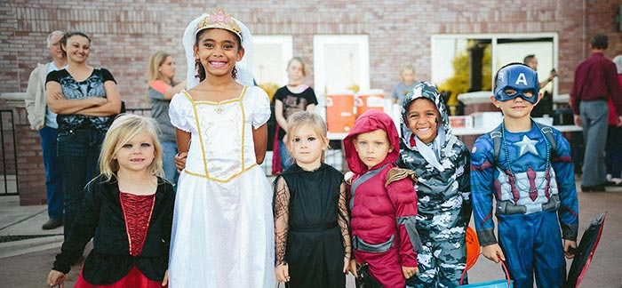 Image of six children dressed up for Halloween trick or treating for Quotacy blog: Saving Money & Staying Healthy.