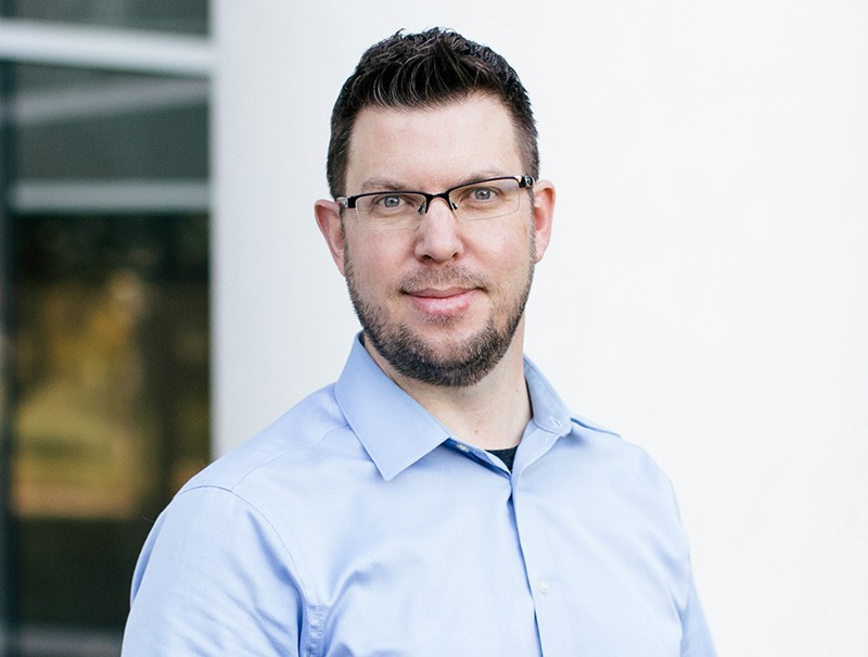 Headshot of Chris Woolcott, Senior Information Architect, at Quotacy, Inc.
