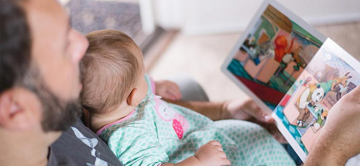 Image of father reading a story to baby girl for Quotacy blog: How Long Should My Life Insurance Last.