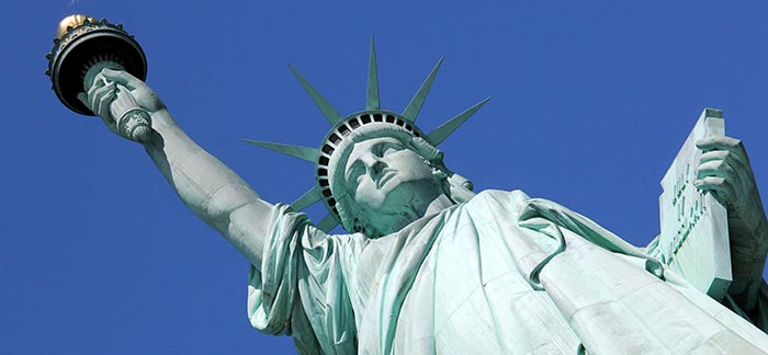 Image of Statue of Liberty at Ellis Island in New York for Quotacy blog: Life Insurance for Non-US Citizens.
