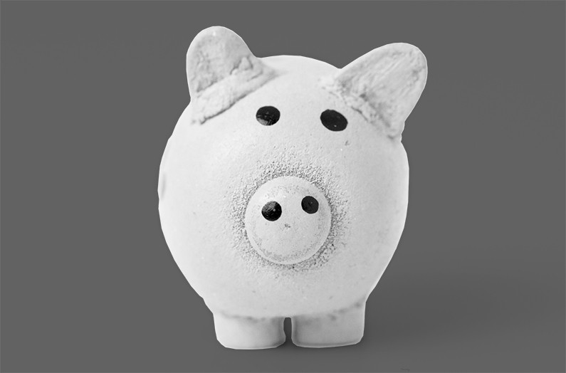 Image of ceramic piggy bank for Quotacy blog How Can I Reduce My Debt?