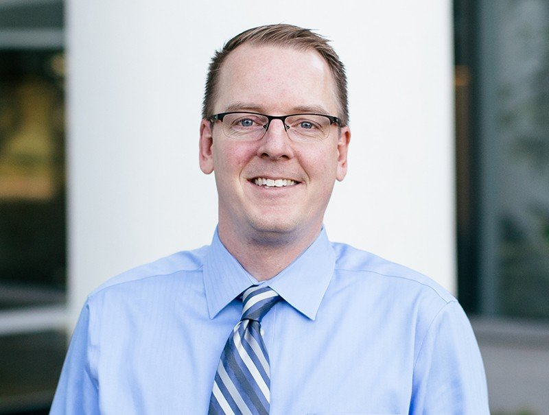 Headshot of Ryan Hallett, President of Quotacy, Inc.
