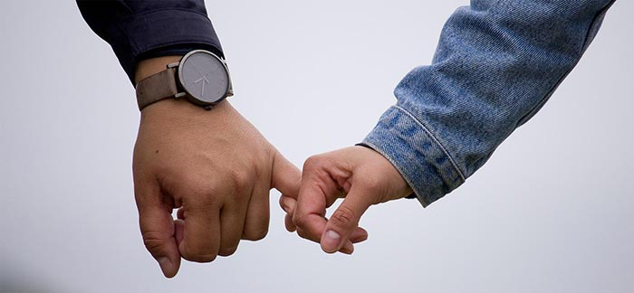 Image of two people holding hands for Quotacy blog: Why You Should Buy Life Insurance.