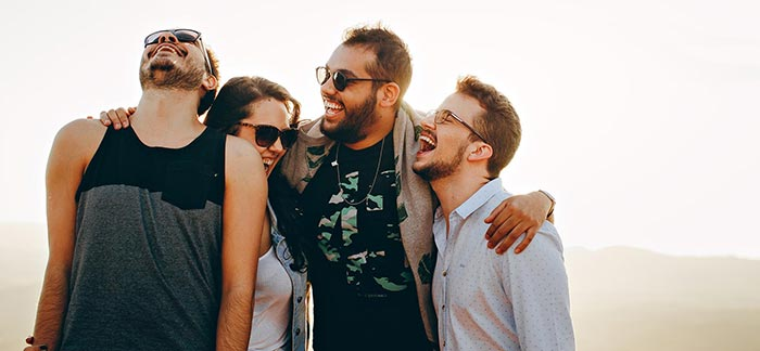 Image of young people together laughing for Quotacy blog Term Life Insurance for Millennials: Simple, Affordable Options.