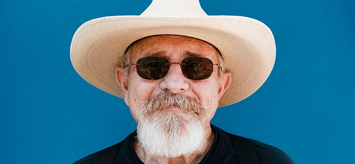 Image of senior man wearing hat for Quotacy blog: Ten Reasons Why It's Not Too Late to Buy Term Life Insurance.