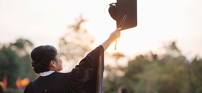 Image of a college grad holding up her cap