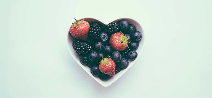 Image of heart-shaped bowl of fresh berries for Quotacy blog: 10 Tips to Ensure You Get the Best Term Life Insurance.