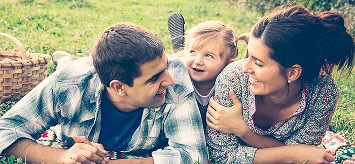 Image of happy family for Quotacy blog: Read This Before Getting a Decreasing Term Life Insurance Policy.