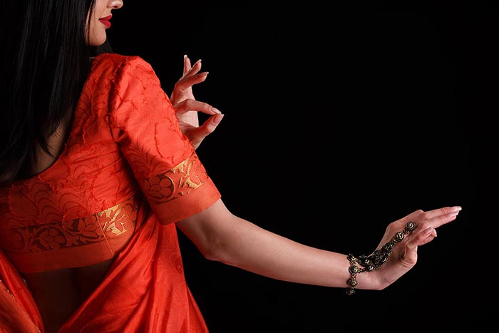 Image of woman belly dancing for Quotacy blog: Trying to Compare Life Insurance Quotes Yourself? Here's 8 Ways to Better Spend Your Time.