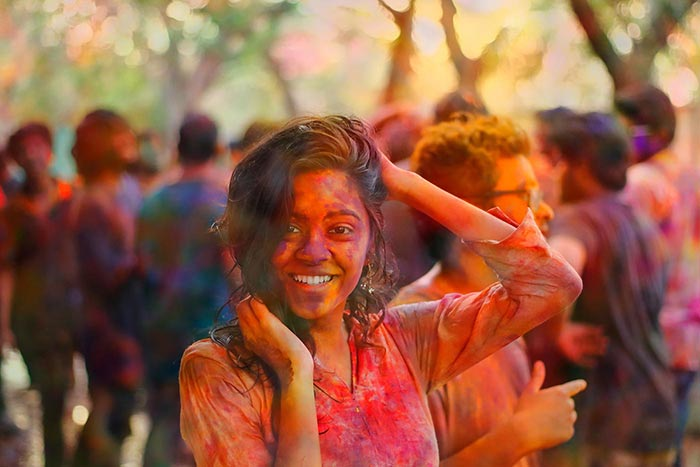 Image of woman splashed with colors, celebrating Holi Festival for Quotacy blog: Trying to Compare Life Insurance Quotes Yourself? Here's 8 Ways to Better Spend Your Time.