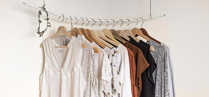clothing hung up for Quotacy blog A Guide to Cleaning Your Closet From Start to Finish