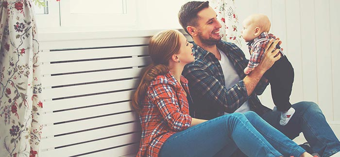 Young couple with baby for Quotacy blog What Is Return of Premium Life Insurance?