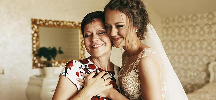 Image of mother and bride for Quotacy blog: Parents Talk to Your Kids About Term Life Insurance Policy.