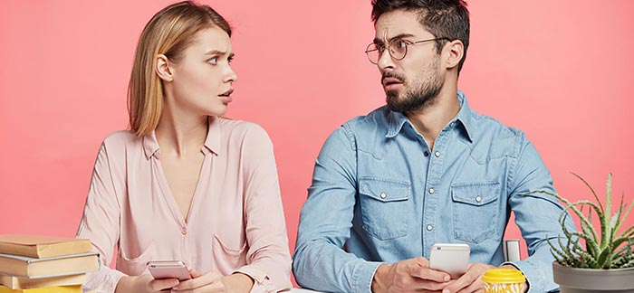 Young couple looking at each other thoughtfully for Quotacy blog 18 Questions to Ask When Getting Term Life Insurance Quotes