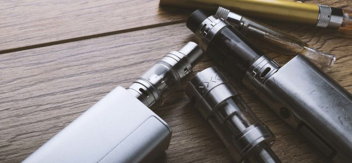 Image of several electronic cigarettes on a table.