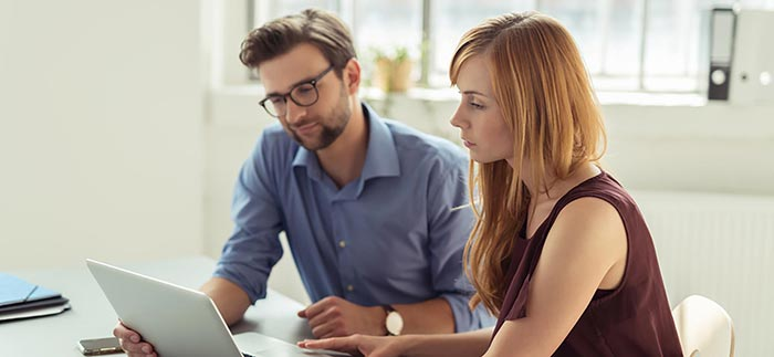 Young couple researching online for Quotacy blog A 5-Minute Guide to Renewable Term Life Insurance