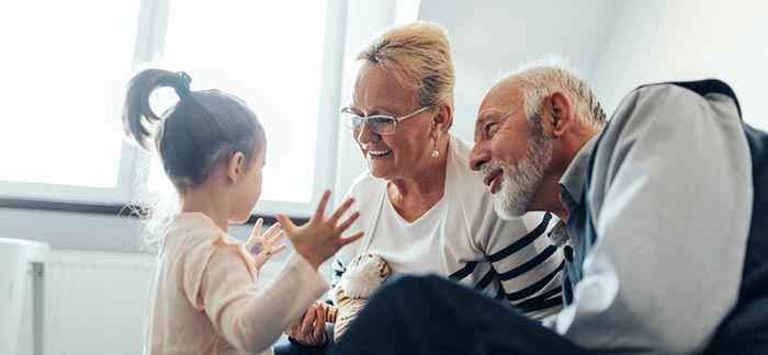 Grandparents talking with granddaughter for Quotacy blog How to Start The Life Insurance Conversation With Your Loved One