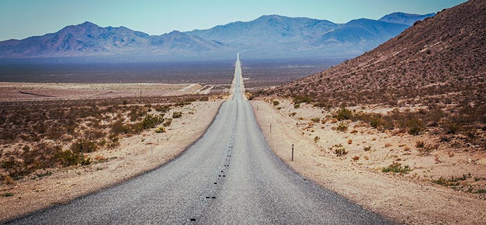 Image of a long road in the desert for the Quotacy blog: How Long Your Term Life Insurance Can Last Just Got Longer.