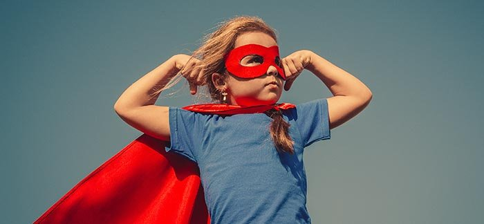 Image of a girl with a cape flexing her muscles for the Quotacy blog: Term Life Insurance Quotes Without Personal Information.