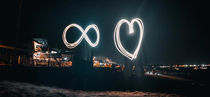 infinity symbol and heart made with sparklers for Quotacy blog What Is Guaranteed Universal Life Insurance?