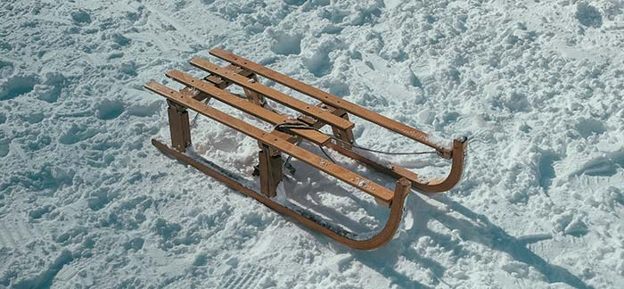 toboggan sled for Quotacy blog Fun Family Winter Activities