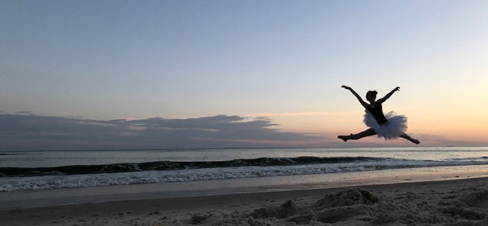 ballerina leaping on the beach for Quotacy blog What Will You Do with an Extra Day This Leap Year?