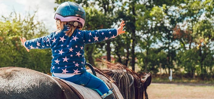 young girl riding a horse for Quotacy blog Are Life Insurance Riders Worth It?