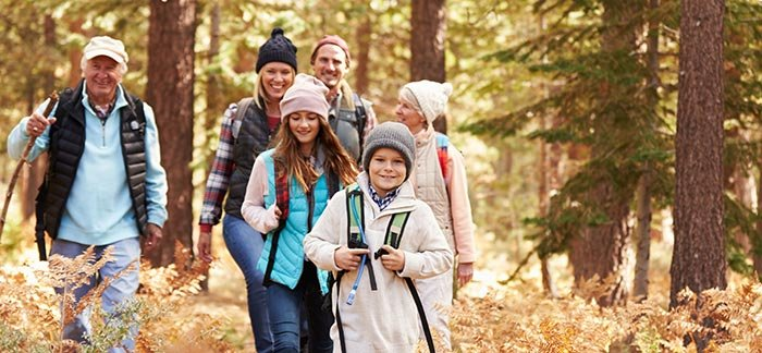 image of family walking through the woods for Quotacy blog Life Insurance Isn't Just for the Wealthy