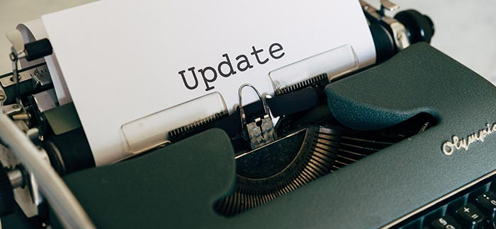 paper with word update in typewriter for Quotacy blog when to update life insurance