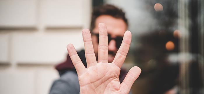 man holding up 5 fingers for Quotacy blog 5 Interesting Life Insurance Questions and Answers