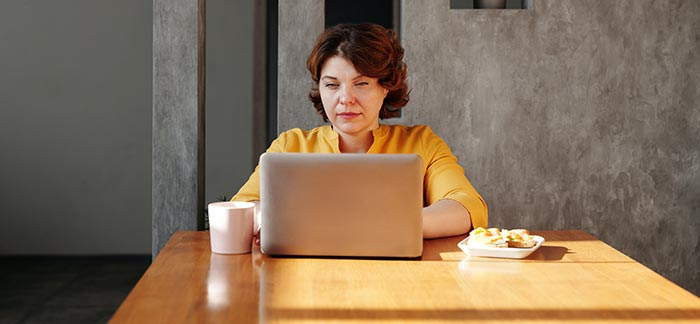 older woman alone at computer for Quotacy blog what's your plan when your spouse dies