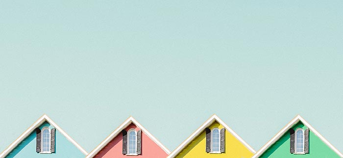 colorful house rooftops for Quotacy blog Creating a Home-Buying Game Plan